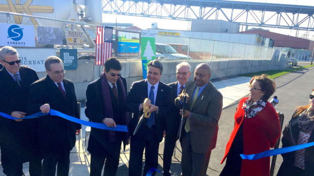 Dana Russikoff (second from right), SureShade's co-founder, is joined by Nicole Vasilaros, vice president of federal and legal affairs at the National Marine Manufacturers Association, at the dedication of the first phase of the Delaware Avenue Extension in Philadelphia. Mayor Michael Nutter is third from right.