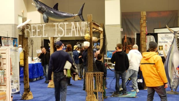 Visitors are shown browsing the Reel Island section of the Providence Boat Show last year.