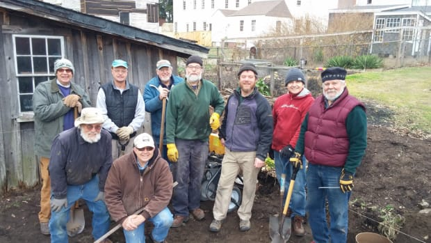 Nate Piper (third from right), director of The Boatshop at Strawbery Banke, and volunteers completed site work for the future facility.