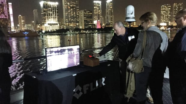 The marine and electronics press had an opportunity to test all of FLIR Systems' latest thermal imaging technology during a cruise Wednesday night. Shown is the M400 thermal night vision camera. The presenter is FLIR Maritime general manager Gregoire Outters.