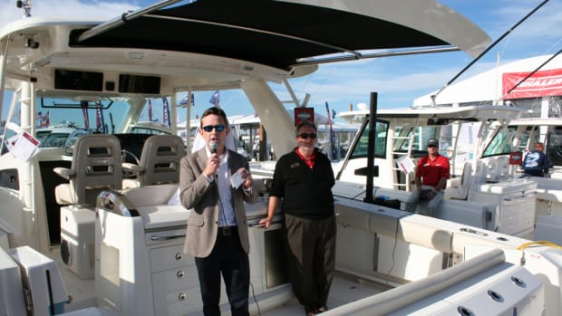 Boston Whaler president Huw Bower (left), and marketing director Jeff Vaughn introduce the manufacturer's new 420 Outrage on Thursday at the Miami International Boat Show.