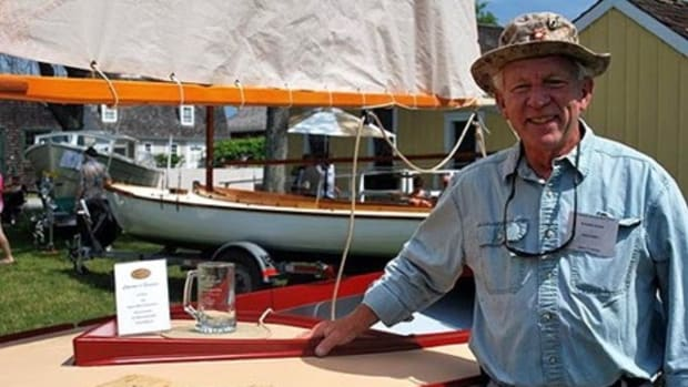 "Richard Honan, of Winthrop, Mass., is shown with his boat Proud Mary II, the 2014 winner of the ""I Built it Myself"" Award sponsored by Interlux at the WoodenBoat Show."