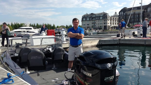 Yamaha manager for government relations Martin Peters is shown next to the new 25-inch shaft model of the 250-hp freshwater V MAX SHO high-performance outboard.