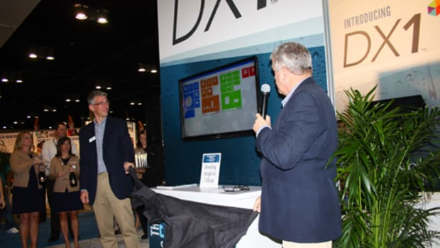 Dominion Marine Media vice president of technology Damir Tresnjo (left) and senior vice president Ian Atkins present the new DX1 software system to dealers on Monday night.