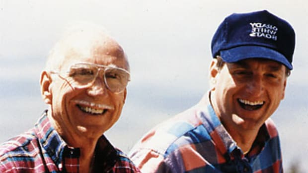 Eddie with his father, George, whom he credits for his business success.