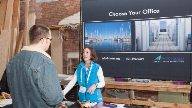 Wendy Mackie, chief executive of the Rhode Island Marine Trades Association, talks with a visitor during the event.