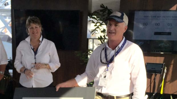 Bertram Yachts general manager Susan Davis and product development manager Tommy Thompson said at the Palm Beach International Boat Show that the new Bertram 35 will be followed by a large convertible, the Bertram 58. Thompson is shown holding a rendering of the 58.