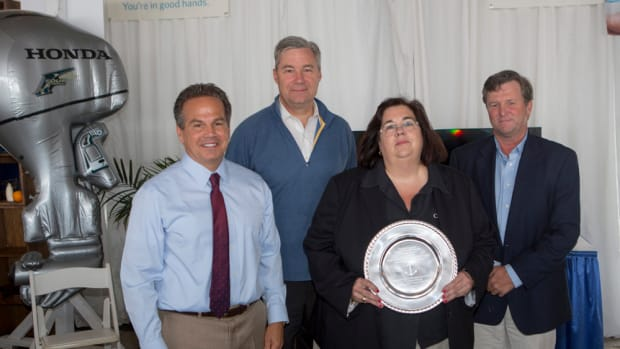 Sally Helme (second from right) received the 2014 RIMTA Anchor Award at the Annual Industry Breakfast on Sept. 13 in Newport, R.I. She is shown with U.S. Rep. David Cicilline, U.S. Sen. Sheldon Whitehouse and Brad Read. PHOTO CREDIT: Billy Black