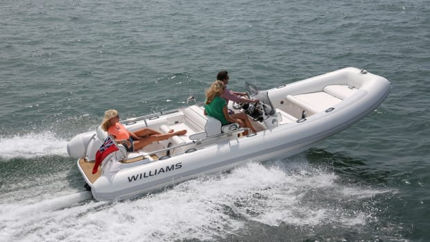 Young people race a boat they designed after taking a course at Williams Performance Tenders.
