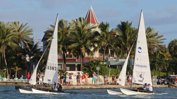 Crews aboard two16-foot-long Hobie Cat sailboats sail past the Southernmost House in Key West, Fla., Saturday, May 16, 2015, just after the start of a more than 90-mile race to Havana, Cuba. The Havana Challenge is believed to be the first U.S. government-sanctioned sailing race between Key West and Cuba in more than 50 years. Five Hobie Cats are participating in the event. FOR EDITORIAL USE ONLY (Rob O'Neal/Florida Keys News Bureau/HO)
