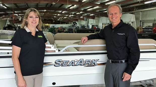 SeaArk Boats founding family member Robin McClendon is shown with Correct Craft president and CEO Bill Yeargin after the acquisition.
