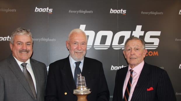 Robin Knox-Johnston (center), the British yachtsman of the year, is shown with Boats.com president Ian Atkins (left) and Yachting Journalists Association chairman Bob Fisher.