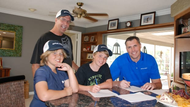 Bayliner Boats is sponsoring nationally ranked champion wakeboard rider Garrett Coleman (center). Coleman, who is 12, will train behind a Bayliner 215 Flight Series Deck Boat.