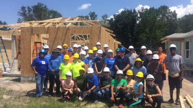 Correct Craft employees helped build a house in Florida for Habitat for Humanity dur-ing the May 14-15 weekend.