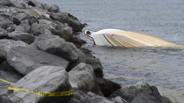 A file photo from the Walton (Fla.) Sun shows the scene of a boat crash in March at the east Destin jetty that killed two people and injured 10 others.