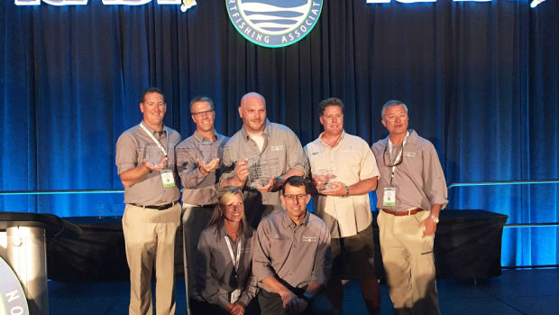 Johnson Outdoors captured the overall Best of Show award at ICAST for its Minn Kota Ultrex trolling motor. Company employees are shown at the Chairman's Industry Awards Reception.
