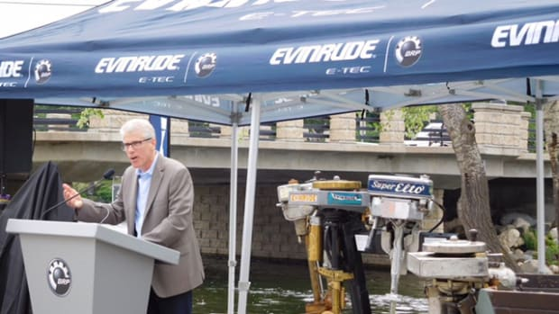 Alain Villemure, vice president and general manager of BRP's marine propulsion systems division, speaks Thursday at the dedication of a memorial to Ole Evinrude, inventor of the outboard engine.