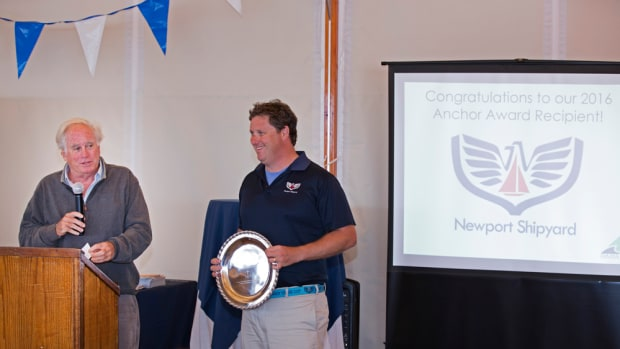 Newport Shipyard managing partner Charlie Dana (left) speaks Saturday during a breakfast at the Newport International Boat Show, where the shipyard received RIMTA's Anchor Award. Shipyard general manager Eli Dana is shown holding the award. Photo by Billy Black.
