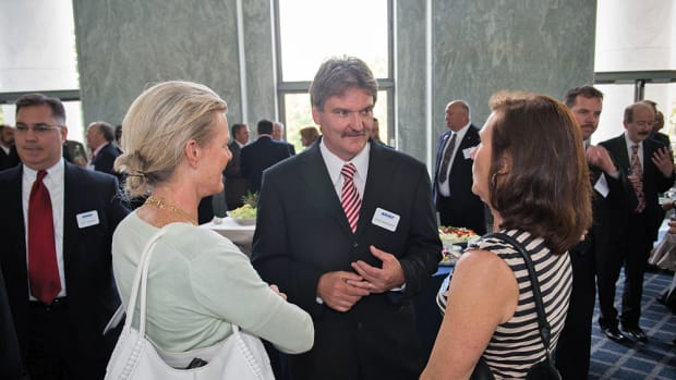 McKnight greets some of the guests at an industry reception on Capitol Hill.