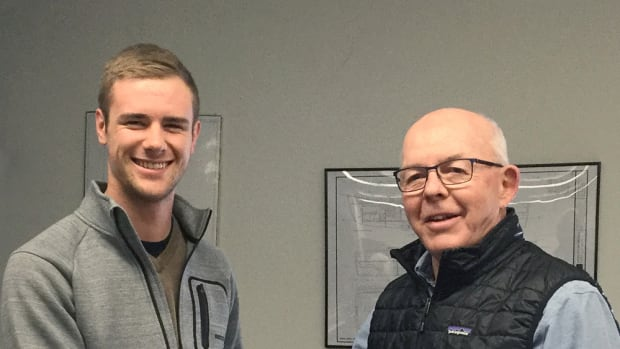 The National Marine Representatives Association presented a $1,500 scholarship to Lane Peterson (left), a student at The Landing School in Arundel, Maine. He is shown with past NMRA president Glenn Hood.