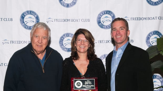 Freedom Boat Club Tampa Bay, owned by Glenn Bergoffen (left), received four of the franchisor's top national awards, including 2016 Franchise of the Year. He is shown with chief operating officer Lisa Reho and Freedom Boat Club president and CEO John Giglio.