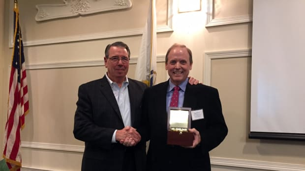 Longtime New England Boat Show president Joe O'Neal (right) received the first Frank Farrell Distinguished Service Award, created in honor of another pivotal New England Boat Show organizer. Massachusetts Marine Trades Association director Larry Russo is at left.