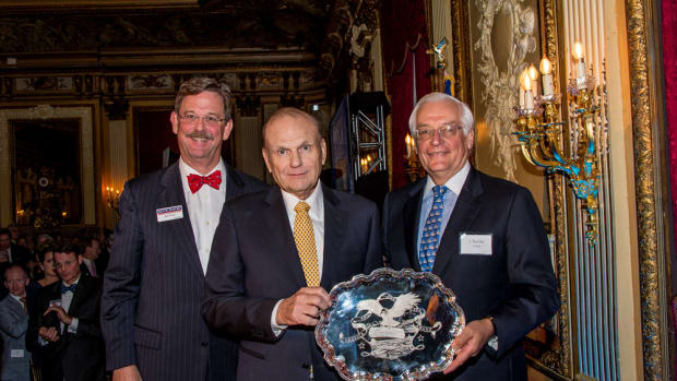 Charles A. Robertson (center) receives the America and the Sea Award in New York City on Nov. 5. Pictured with Robertson are Mystic Seaport president Steve White (left) and Board Chairman J. Barclay Collins (right).