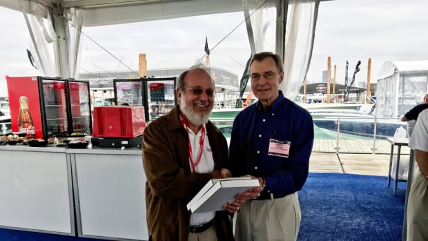 Jim Flannery, of Soundings and Anglers Journal — both Active Interest Media publications — captured four awards at the Boating Writers International writing awards competition today. Flannery (left) is shown accepting one of the prizes from BWI executive director Greg Proteau.