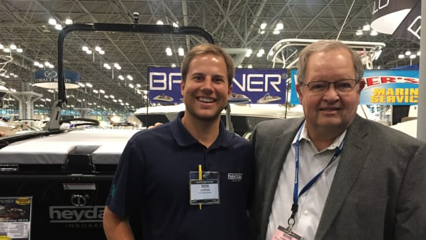 Brunswick CEO Mark Schwabero (right), shown with Heyday founder Ben Dorton at the New York Boat Show, discussed concerns about potential import taxes with investors before heading to the show.