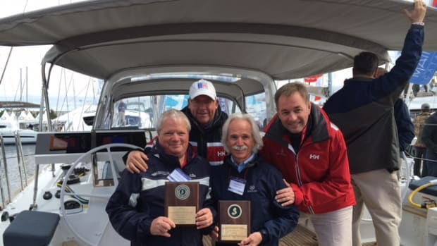 Shown are Beneteau U.S. sailboat sales manager Chris Doscher (rear, at left); Beneteau America president Laurent Fabre (rear, at right); Dave Fulbright, of Sail Place (front, at left); and Tim Fulbright, of Sail Place.