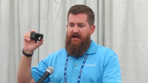 A Garmin representative pitches the company's new Vibe XE at Tuesday's event.