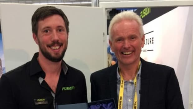 Fusion Northern Europe sales manager Kevin Lott (left) presents the company's EMEA Distributor of the Year Award to ProNav AS managing director John Hestnes.