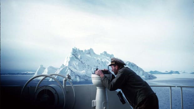 J. David Power III is shown navigating the Coast Guard icebreaker Eastwind in 1955.