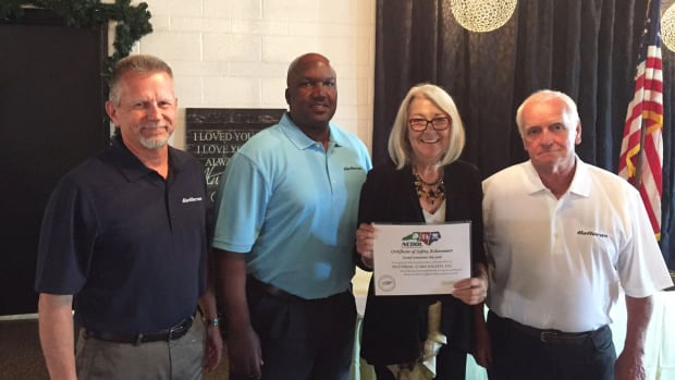 From left: Hatteras Yachts vice president of manufacturing Tim Varner and EH&S specialist Hezekiah Harper, commissioner Cherie Berry, and honoree Tommy Ormond, Hatteras Yachts group leader.