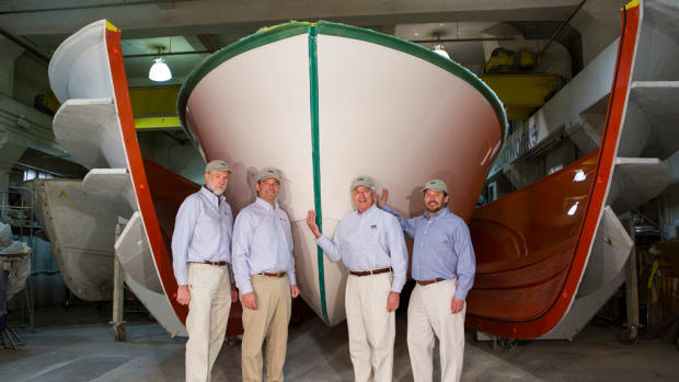 Shown with the first MJM 50z as it comes out of the mold are MJM team members (from left) Mark Lindsay, Scott Smith, Johnstone and designer Doug Zurn.