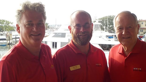 Travis Staats (center), the new marina manager at Camachee Cove Yacht Harbor, is shown with Peter Sabo (left), president and CEO of Camachee Island Co., and Joe Taylor, chairman of Camachee Island Co. and owner of Camachee Cove Yacht Harbor.