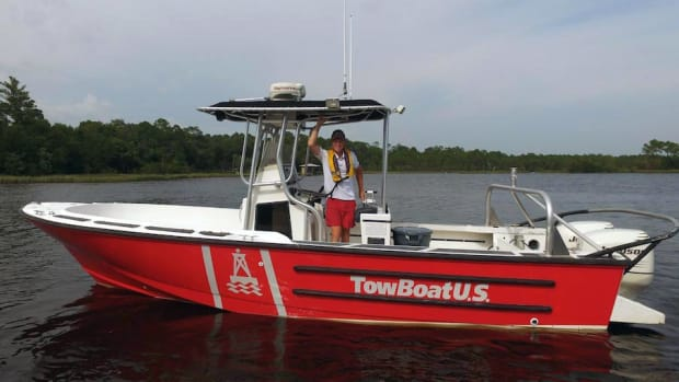 Capt. Conrad Morris is shown at the helm of one of his towboats.