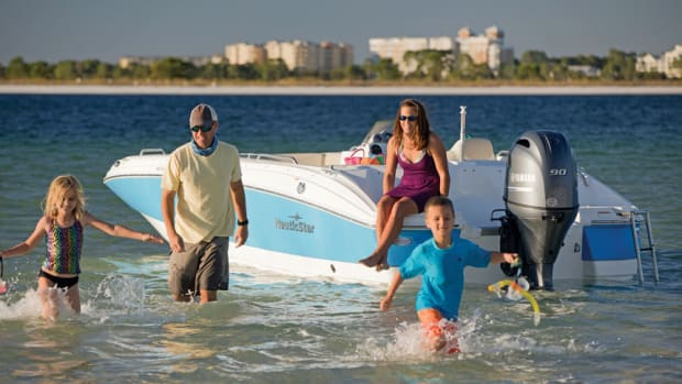 family-walking-to-shore-from-boatx860