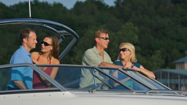 two-couples-on-boat-with-sunglasses