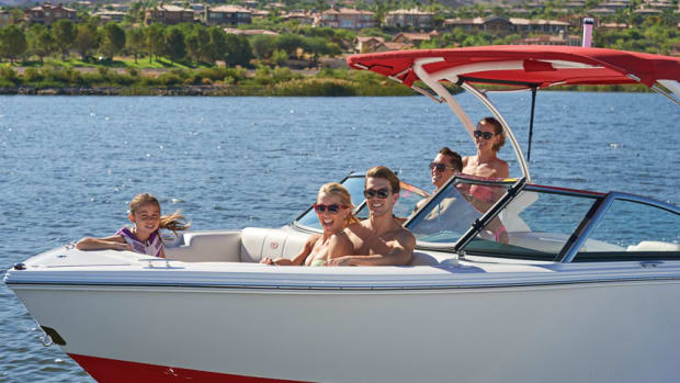 two-couples-and-child-having-fun-on-boat