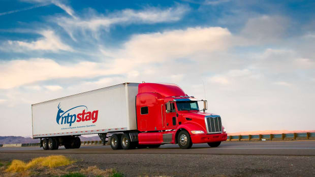 1.-NTPStag-Red-Truck-Moving-On-A-Highway-4380639_1800