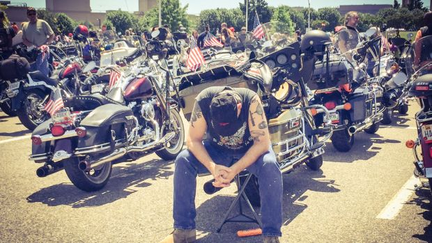 A young soldier is deep in thought before leaving from a Pentagon parking lot with other riders during the Rolling Thunder XXVIII First Amendment Demonstration Run on Sunday.