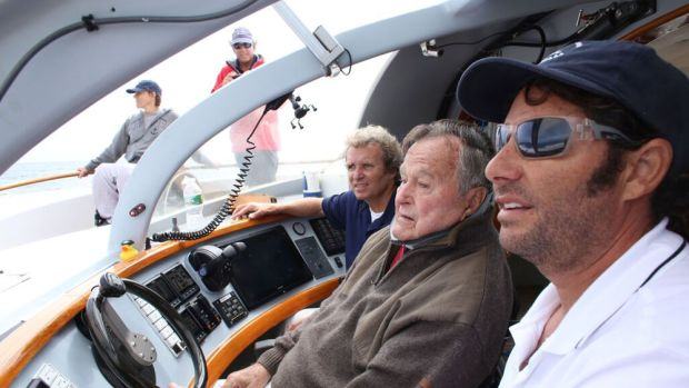 Harry Horgan (left), former President George H.W. Bush and Capt. William Rey are shown aboard the Impossible Dream. PHOTO CREDIT: Evan Sisley, Office of George Bush