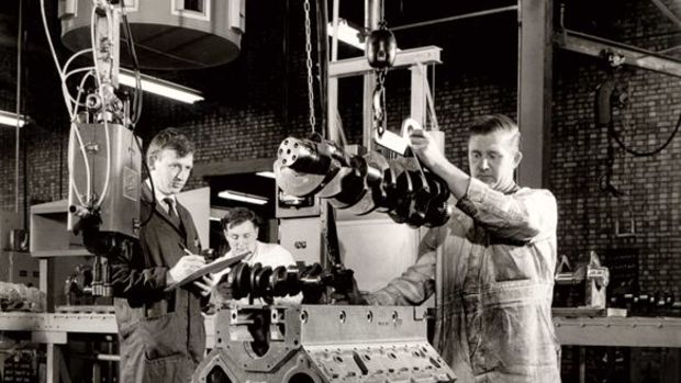 Cummins Darlington employees are shown at work on a Small Vee engine during the 1960s.