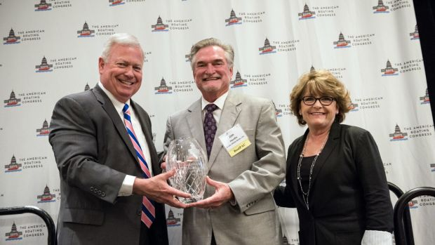 NMMA president Thom Dammrich (left) presents the 2017 BoatPAC Champions for Growth Award to Grady-White Boats. Accepting are company president Kris Carroll (right) and compliance/government affairs manager Jim Hardin.