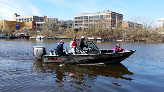 Evinrude E-TEC-powered boats picked up trash along the Milwaukee River basin during an Earth Day event on Saturday.