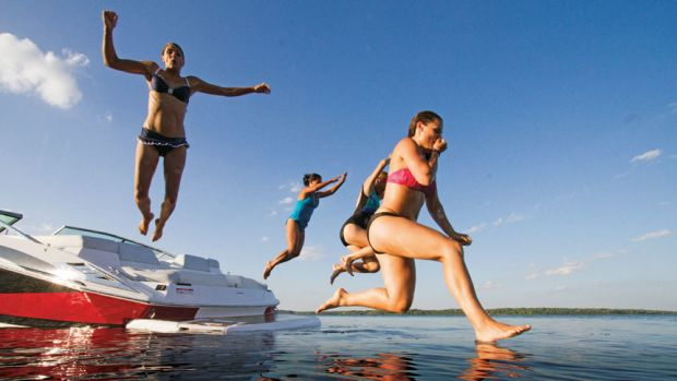 girls-jumping-in-water