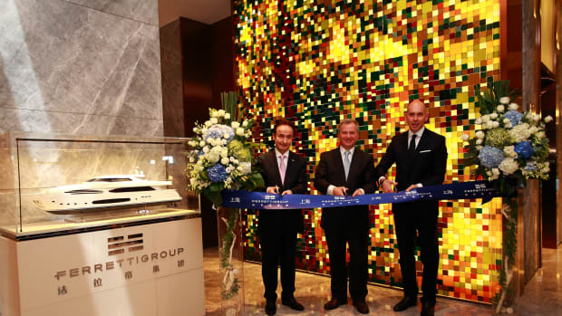Pierre Barthes (left), Stefano Beltrame and Alessandro Tirelli are shown at the ribbon cutting for the Ferretti Group's new office in Shanghai.