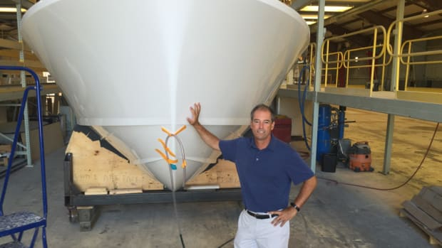 Bertram Yachts CEO Peter Truslow is shown with hull No. 3 of the Bertram 35, which is being assembled and completed at the new Tampa facility.