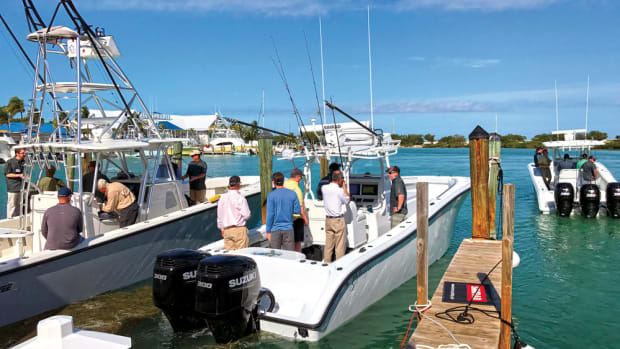 About 30 journalists this winter came to the Florida Keys to check out Navico's latest offerings under the Simrad, Lowrance and B&G brands. Here, Navico product manager Matthew Laster (right) talks about the Simrad electronics on a 34-foot Yellowfin.